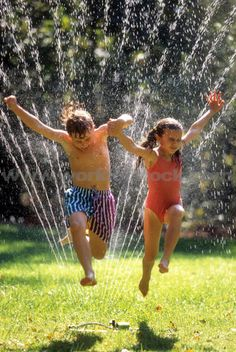 hot day playin in  the sprinklers