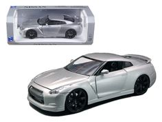2009 Nissan GT-R R35 Silver 1/24 Diecast Model Car by New Ray - Brand new 1:24 scale diecast model car of 2009 Nissan GT-R R35 Silver die cast car model by New Ray . Rubber tires. Brand new box. Detailed interior, exterior. Has opening hood and doors. Made of diecast with some plastic parts. Dimensions approximately L-8, W-3.55, H-3.55 inches. Please note that manufacturer may change packing box at anytime. Product will stay exactly the same.-Weight: 2. Height: 6. Width: 11. Box Weight: 2…