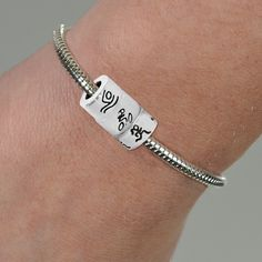 A runner's bead, a biker's bead, and a swimmer's bead complete a sterling silver triathlon to cherish as a memorable keepsake. Comes on a beautiful sterling silver snake bracelet!