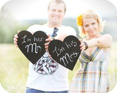 Super cute photo props! You could just spray some wooden heart shapes with chalkboard paint! :)