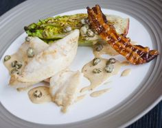 John Dory with Baby Gem and Smoked Garlic Dressing - Delicious fresh flavours complement this light and tasty fish perfectly - http://www.fishisthedish.co.uk/recipes/main-meals/1413-john-dory-with-baby-gem-and-smoked-garlic-dressing