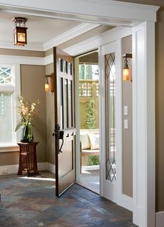 A warm and welcoming front entrance with slate tiled floors  (via Custom Craftsman - traditional - entry - san diego - by Dorothy Howard AIA, Architect)