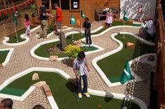 UrbanCrazy is a pioneering company providing portable crazy golf and minigolf entertainment and installing permanent miniature golf courses across the UK. Golf Putting Green, Crazy Golf, Miniature Golf, Back Gardens, Outdoor Projects, Baseball Field, Water Features, Golf Courses, New Homes