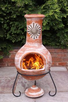 Extra large family sizes chimenea in a rustic orange colour. These chimeneas are hand made and hand painted and therefore colours and shape may vary very slightly as each chimenea is unique. This chimenea comes complete with rain lid and steel stand. Clay chimeneas have been used for centuries in Central America and have been designed so that only small fires are needed to heat the entire chimenea. We recommend covering your chimenea when not in use and bringing indoors during bad weather.
