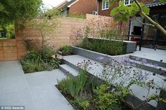 Blue Grey Granite Paving has been used in this award-winning design by Rosemary Coldstream. We think the consistent colouring of the slabs complements the planting beautifully! Patio Steps, Garden Steps, Back Garden Design, Garden Design Plans, Garden Paving, Terrace Garden, Hill Garden, Small Gardens, Outdoor Gardens