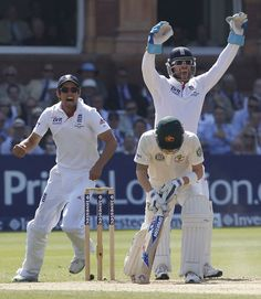 England celebrate after Michael Clarke was caught at leg slip for 51