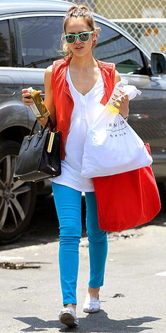 EXPRESS SKINNIES  The queen of colorful jeans, Jessica Alba, has a bright pair in every shade and at every price point – including these $79.90 tropic blue Express jeggings, which she smartly pairs with a bright coral top and neon shades.