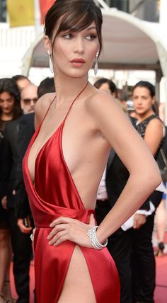 Bella Hadid, just 19 and already a rising model, showed off her stunning figure at the Cannes Film Festival. She wore a plunging fire-red, spaghetti-strap gown with a thigh-high split that let everyone know she was nude underneath. It's a wonder she kept her private parts from public view. Read More and See 10 New Photos! Click Here: http://go.shr.lc/1V9OnV3