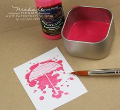 Paint splatter process stamping with clear embossing powder and acrylic paint over it as a resist.