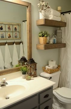 Love this mirror frame... Hallway bathroom makeover with only $100 for the $100 Room Challenge. Love this paint color.