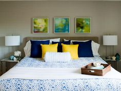 A wallpaper accent wall is much cleaner than the painted circus stripes this master bedroom used to have. The space feels brighter and cleaner as your eye is drawn through the space. As seen on HGTV's Buying and Selling With the Property Brothers
