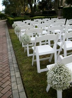 Baby's breath making a comeback - here in pomander balls on the chairs.  Linear Park at Reunion Resort