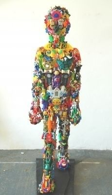 Robert Bradford creates his art using discarded toys: http://greenstreamline.com/blog/post/discarded_toys_get_a_new_life_the_work_of_robert_bradford