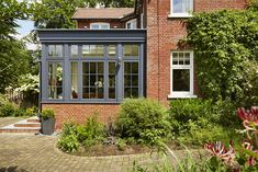 Seven Useful Shade Tolerant Groundcovers For Tough Spots South Facing Orangery Was Painted In A Modern Westbury Black. Garden Room Extensions, House Extensions, 1930s House Exterior, Kitchen Orangery, Orangery Extension, Westbury Gardens, House Extension Design, Edwardian House, Exterior Remodel