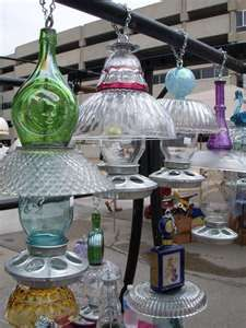 one-of-a-kind glass bird feeders at the downtown Cedar Rapids Farmers Market. Mike Shannan makes beautiful yard art out of recycled glass bottles, jars, bowls and more. Hanging Bird Feeders, Diy Bird Feeder, Hummingbird Feeders Diy, Bird House Feeder, Glass Flowers, Glass Birds, Flower Pots, Flower Planters, Glass Garden Art
