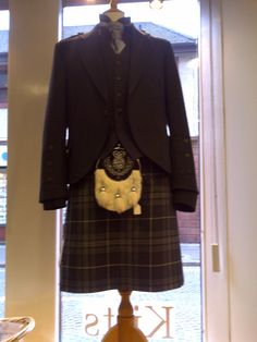 """Get rid of the half-a-rabbit-looking sporran, ridiculous sock tie, and epaulettes - """"Grey Granite"""" kilt outfit, available from Highlander Tartan Wear, Ayrshire, Scotland.  www.highlander.uk.com"""