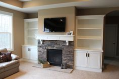 built-in shelves surrounding fireplace | ... built in cabinets and shelving surrounding their fieldstone fireplace