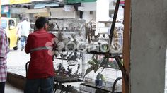 Men picking Bird from a Cage in Malaysia - Stock Footage   by JahnProductions