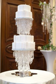 Is there anything more chic than a chandelier? Elizabeth's Cake Emporium designed a hanging wedding cake chandelier — just don't try and swing from this one!
