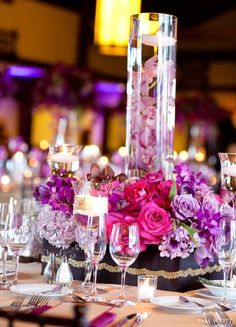 Pink & Purple Centerpiece, roses, water cylinder vase with orchids.