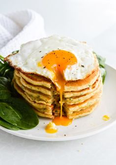 savory pancakes with fried egg and spinach