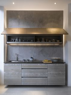 :: Havens South Designs :: loves this small but well appointed kitchen from Roundhouse. These are Urbo bespoke kitchen cabinets in Driftwood with wall cabinet in Burnished Bronze finish