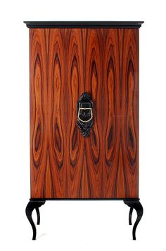 Guggenheim Cabinet from Boca do Lobo / available in two finishes (rosewood or palinsander), and has a lacquer wood top and legs in black. It is made from natural wood, the interior has tree shelves.