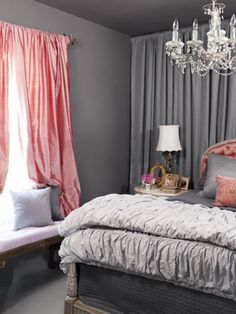 Soft grays with just a splash of peachy pink. See how the wall of gray fabric adds softness behind the headboard.  How do you light the texture of the folded duvet?
