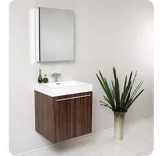Photographic Gallery This Fresca Alto modern bathroom vanity features a walnut finish and stainless steel hardware The vanity includes a mirror which plements the lines of