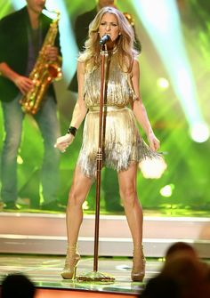 "Later that same evening, Celine hit the stage for an inspired performance of the Ike & Tina Turner classic, ""River Deep - Mountain High,"" in a gold fringed Versace halterneck dress and strappy, nude-hued stilettos that highlighted her gorgeous gams."