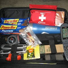 Emergency Car Survival Kit. Contains:  Jumper cables; Multi-Tool; Map; First-aid kit; Flashlight; Rag; Duct tape; Rain coat; Emergency blanket, Folding shovel, Fuses for fuse box; Water bottles; Protein bars or M.R.E.; Reflective tape or reflective triangles; Old Cell phone, fully charged; Lighter or water proof matches, or flint rod; Compass; 550 cord or paracord. Interestingly, I realized that I have almost all of these in my car, plus some winter survival stuff.
