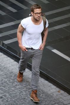 Ryan Gosling's relaxed street style: plain white tee with scoop neck, grey jeans and light brown boots.