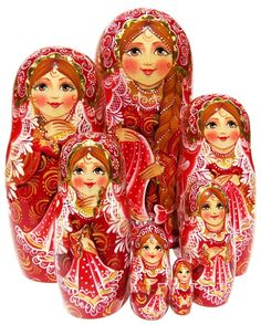 7 piece nesting doll is dressed in red and white traditional Russian costume and hand crafted with inlaid golden foil. Only 1 for sale. Free shipping.