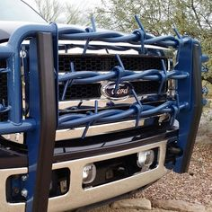 Hand-forged Big Barbs Full Grill Guards have a durable powder-coated finish like this blue one on a Ford 250. All brackets and hardware included for an easy bolt-on application!  Functional and decorative!  Custom sizes, colors and styles available!