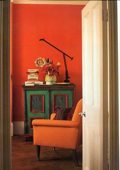 """Too Hot to Handle. Eclectic Style living room with Persimmon Orange walls, Tangerine Orange chair and painted cabinet in Hunter and Kelly green featured in Tricia Guild's book """"In Town"""" Orange Rooms, Orange Walls, Orange Room Decor, Tricia Guild, Interior Decorating, Interior Design, Decorating Ideas, Decor Ideas, Eclectic Decor"""