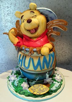 3-D Pooh in a hunny pot. Mostly edible with some non- edible elements.