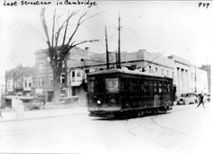 Facing the corner of Wheeling Avenue and East 8th Street. Inter-urban trolley passing the courthouse.