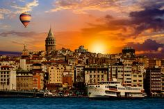The skyline of #Istanbul by dawn. Who wants to be in that hot air balloon?