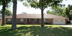 This charming brick home is a must see in a great Coffeyville neighborhood. This 3 bedroom, 2 bath home has a large backyard and tons of room for storage! The living room boasts a beautiful brick feature wall with a wood-burning fireplace and french doors leading out to the back patio. You will love the spacious bedrooms and closets. Call for a showing today!