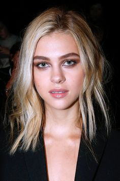 Nicola Peltz: Nicola attended the Balenciaga show in Paris with smudgy brown eye shadow and radiant skin.