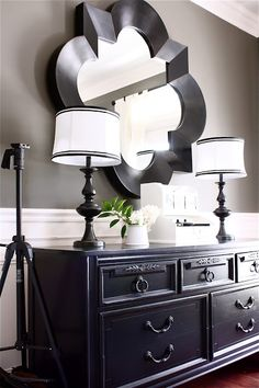Love the mirror in the dining room/ home office.  Love the lamps and the refurbished thrift store dresser that serves as a buffet.