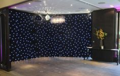 Devonshire Terrace - Starcloth backdrop, rotating mirrorball and wall uplighters in magenta by www.stressfreehire.com #venuetransformers