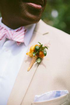 citrus inspired boutonniere // photo by Caroline Ghetes // http://ruffledblog.com/colorful-sonoma-valley-wedding