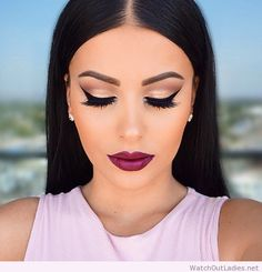 Shimmery neutral cat eye makeup, wine lips