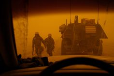 U.S. Marines are caught in a ferocious dust storm in the desert south of Baghdad at noon on March 25, 2003.