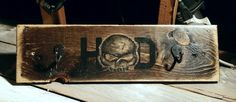 Harley inspired creation I did for a lady. Screws to studs, has hooks, carved skull. #harley #home decor #man cave #wood decor #diy #Harley Davidson #rustic