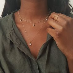 Delicate layers featuring the cz diamond drop choker, the X ring and a 9k gold necklace with charm that's coming soon.
