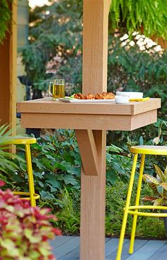 Add dining space for large groups by attaching tables to deck supports posts. --Lowe's Creative Ideas