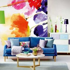 Statement living rooms don't come much more striking than this. Inspired by the watercolours of Monet and Manet, furniture and soft furnishings in watery blues are layered against a super-sized floral backdrop to create a room that's a modern masterpiece.   Printed wall mural - Digitex