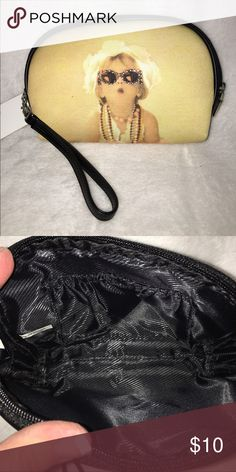 Girlfriend Purse This adorable purse has crystals on the front and the same picture without crystals on the back. It can be carried with or without the detachable wrist strap. The large interior has one elastic open pocket Bags